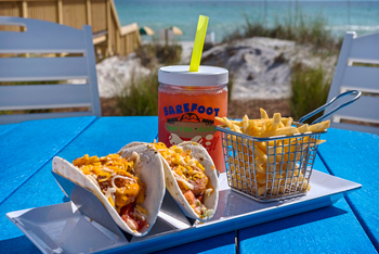 Fish Tacos with Fries and Beach in background